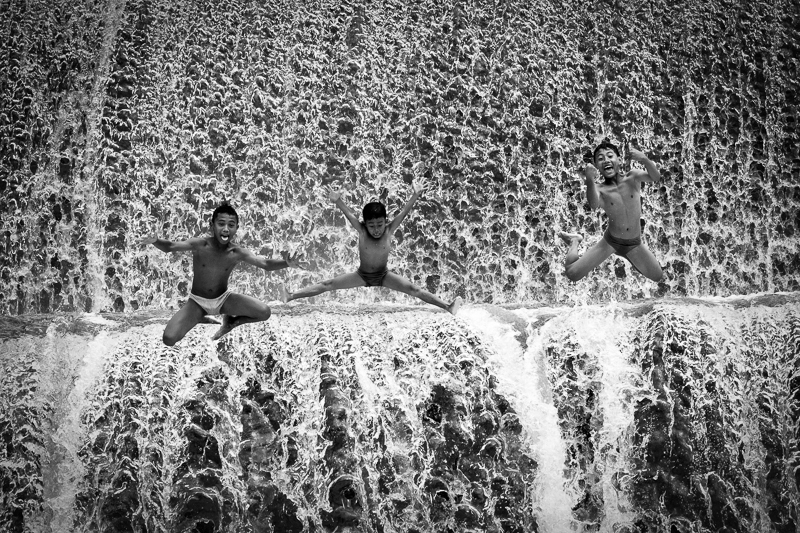Jump to unda river bali bw people fine art series